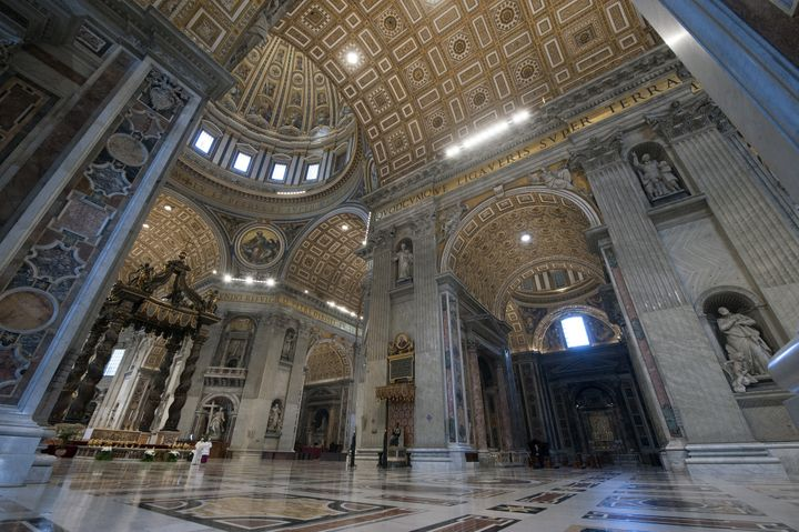 Pope Francis gives a blessing on Easter Sunday inside an empty Vatican Basilica.
