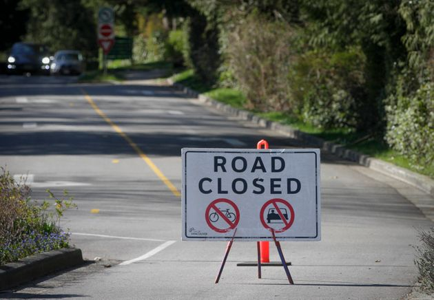 A sign is pictured on the road to Stanley Park to prohibit vehicles in order to maintain social distancing...