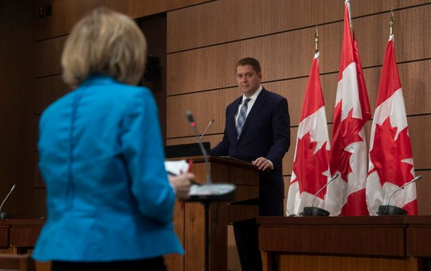 Conservative Leader Andrew Scheer listens as a reporter asks a question during a news conference in Ottawa...