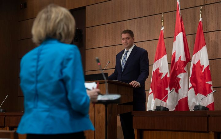 Conservative Leader Andrew Scheer listens as a reporter asks a question during a news conference in Ottawa on April 14, 2020.