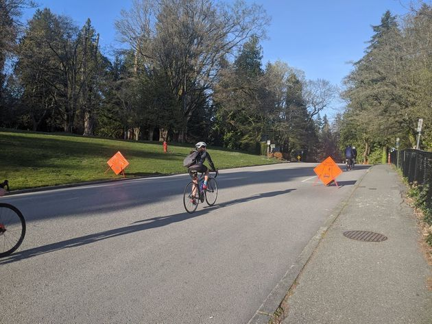 Cyclists take advantage of a closed road in Vancouver's Stanley