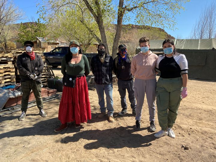 Relief workers pose at a farm used as a base for aid to Navajo families quarantined in their homes due to COVID-19 in Hogback