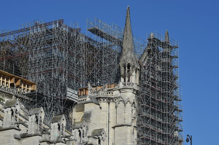 The scaffolding of Notre-Dame Cathedral is seen after repair work stops due to the coronavirus outbreak one year after fire r