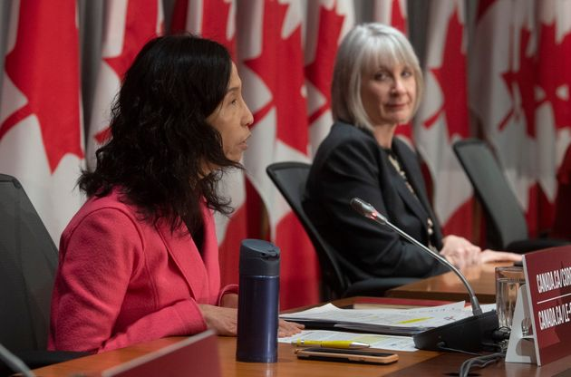 Chief Public Health Officer Theresa Tam, left, addresses the media during a news conference on Tuesday...