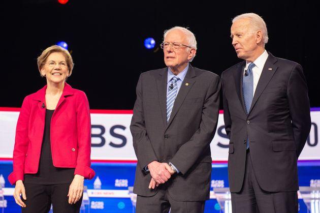 From left to right, U.S. Sen. Elizabeth Warren, U.S. Sen. Bernie Sanders and former U.S. vice-president...