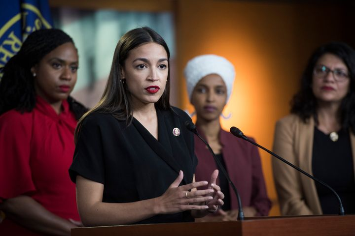 Rep.Alexandria Ocasio-Cortez (D-N.Y.) speaks in July as fellow Squad members and Democratic Reps. Ayanna Pressley (Mass