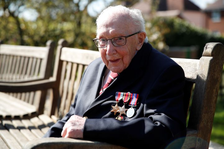 Retired British Army Captain Tom Moore, then 99, midway through his successful attempt to walk the length of his garden 100 times before his 100th birthday