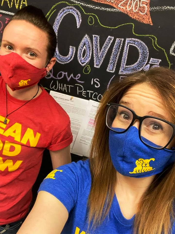 Petco employees wearing masks sewn from old uniforms.