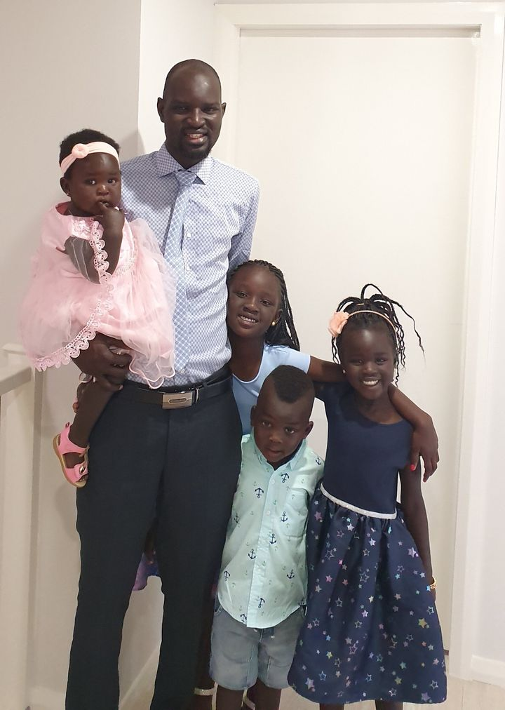 Dor Akech Achiek, shown here with his four children, arrived in Australia as a refugee in 2003.
