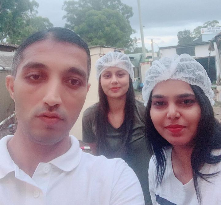 Chowpati restaurant owner Vatsal Harshadkumar Shah, left, with two staff members. The restaurant offers free meals for struggling international students.