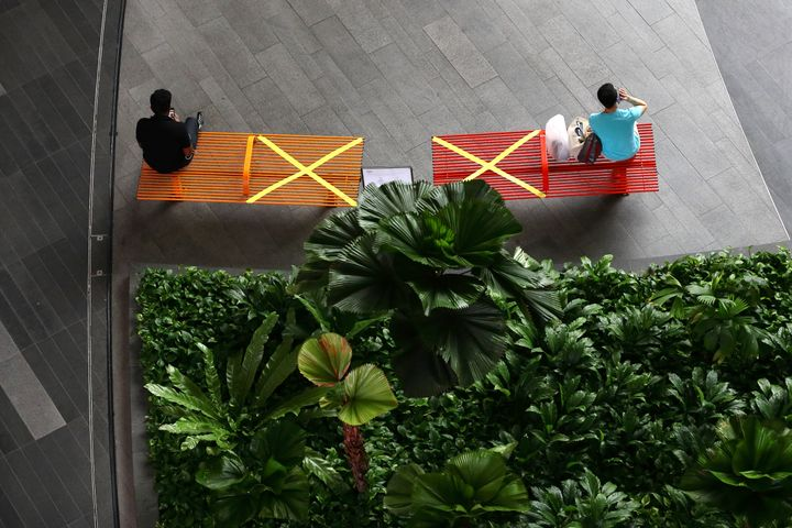 """""""X"""" marks the spot: People in Singapore practicing social distancing last month."""