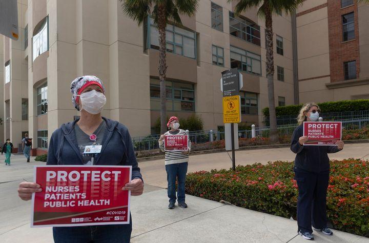 Health care workers are seen protesting outside Santa Monica's UCLA Medical Center. Nurses atProvidence Saint John&rsqu