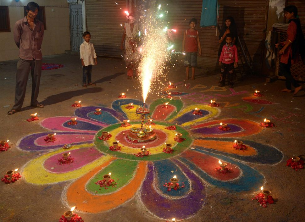 <em>Hindus, of which there are at least 2 million in Pakistan, celebrate Diwali with fireworks in Karachi on Nov. 3. (RIZWAN