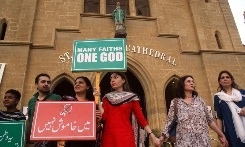 <em>Demonstrators formed a wall around Karachi's Catholic Cathedral last fall during national protests calling for the freedo
