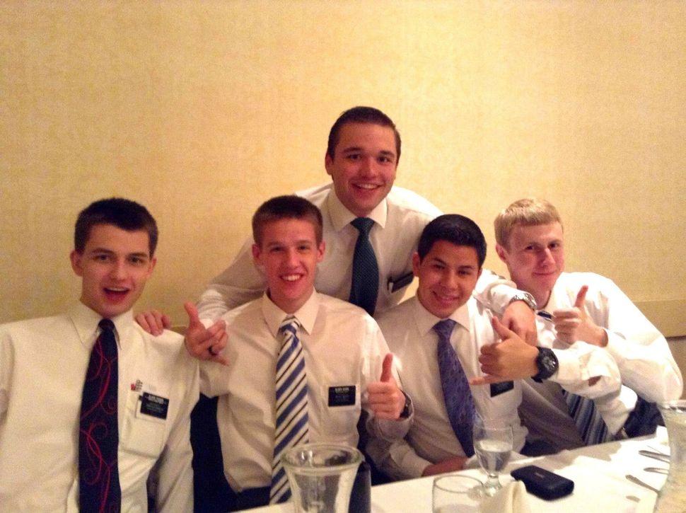 <em>Ryan Tucker, left, with his fellow missionaries.</em>