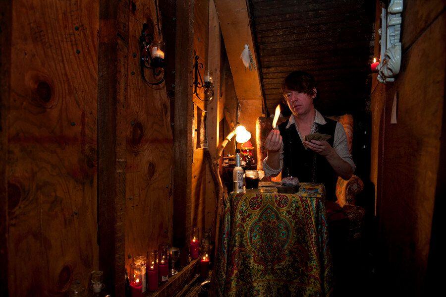 <em>Damon lights Palo Santo at Catland in Bushwick, Brooklyn. (Wendy George/Huffington Post)</em>