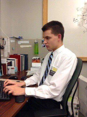 <em>Tucker at a cubicle at the Referral Center Mission.</em>