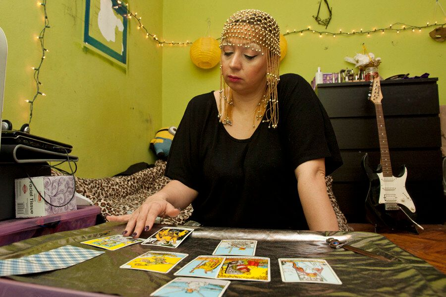 <em>Crimson Kitty does a reading in her apartment in Bushwick, Brooklyn. (Wendy George/Huffington Post)</em>