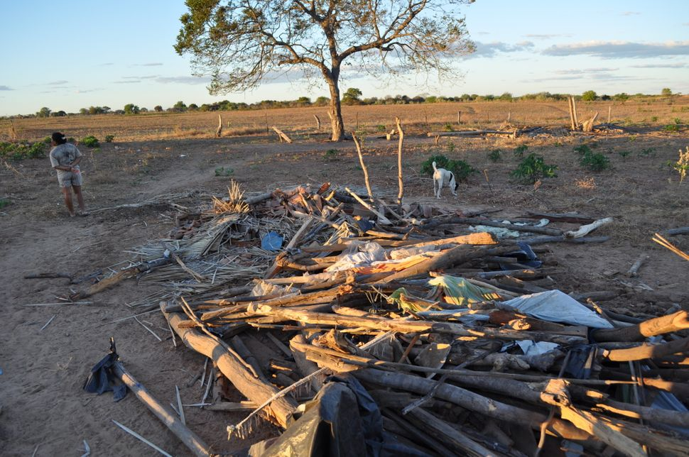 <em>This photo, taken July 5, 2010, shows the ruins of the quilombo association's makeshift shelter, which the police destroy