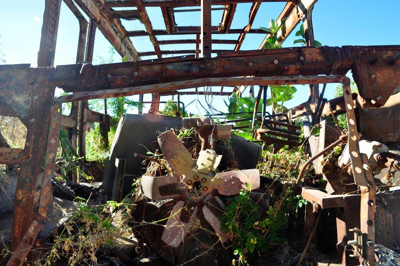 "<div class=""feature-caption""><em>The charred remains of a bus set ablaze in 2010 remain standing on the main street of Barra do Parateca, Brazil. (Carolina Ramirez/The Huffington Post)</em></div>"