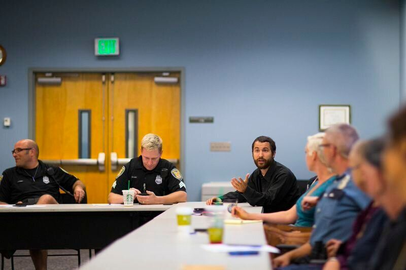 <em> LEAD (Law Enforcement Assisted Diversion) caseworker Tim Candela, right, attends a LEAD meeting at the SPD West Precinct