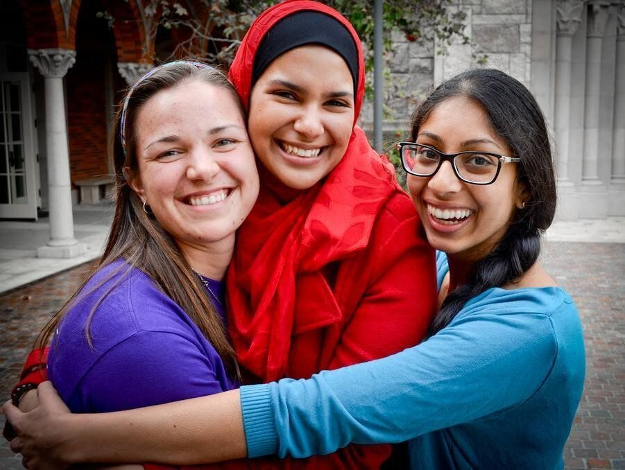 """Engie Salama (center) with friends at the USC Interfaith Block party.  """"I recognized a need for interfaith involvement be"""