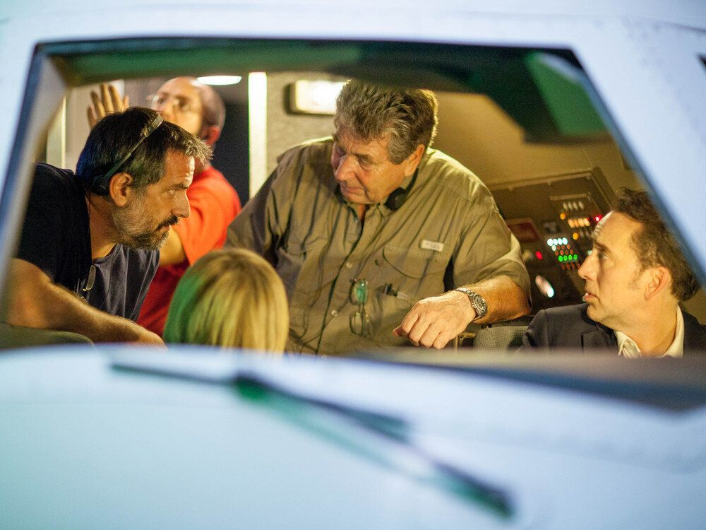 """<div class=""""feature-caption""""><em>Lalonde, left, with director Vic Armstrong, center, and Nicolas Cage on the set of """"Left Behind"""" in August 2013. (Photo: Stoney Lake Entertainment)</em></div>"""