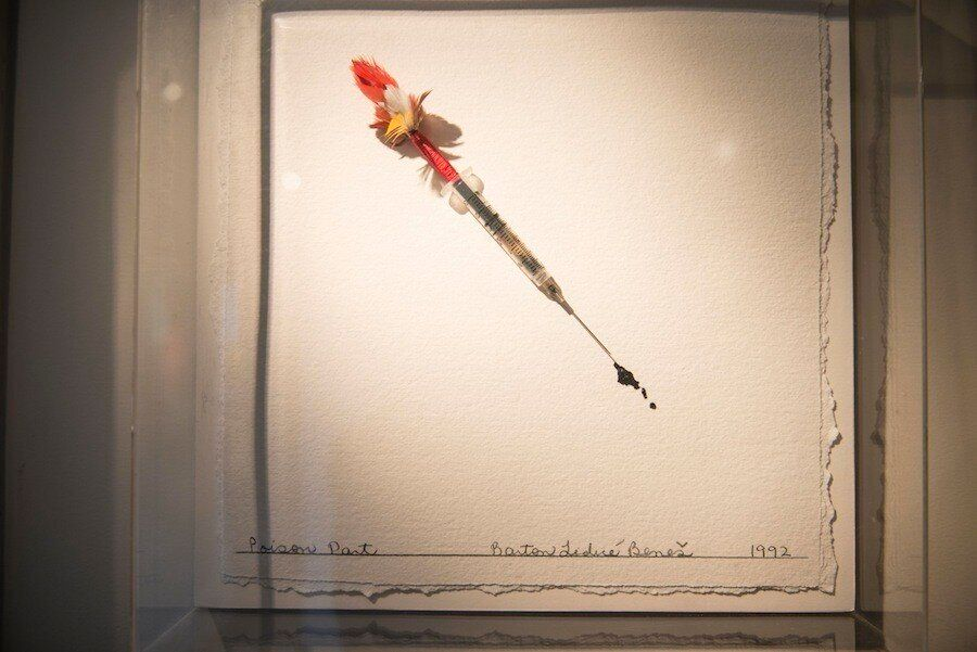 "<em>The ""poison dart"" by artist Barton Benes. The piece is a hypodermic needle with Strub's blood splurging out of it. ""[It]"