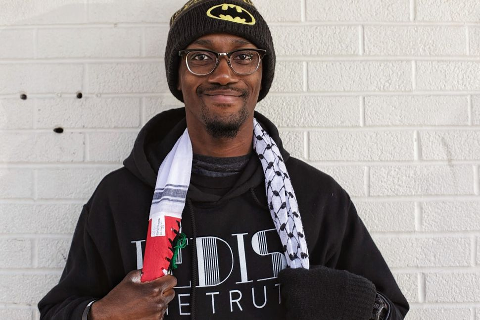 <em>Larry Fellows III took time off from his job to join the Ferguson protests. (Emily Kassie/The Huffington Post)</em>