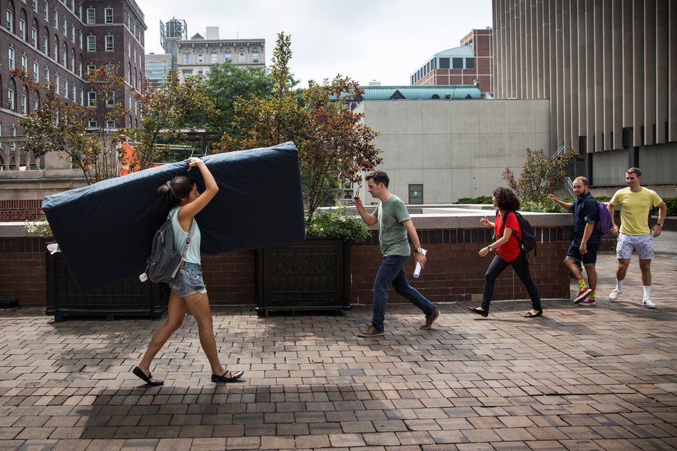 <em>Emma Sulkowicz, a Columbia University senior, says she'll carry her mattress around campus for as long as the man who s