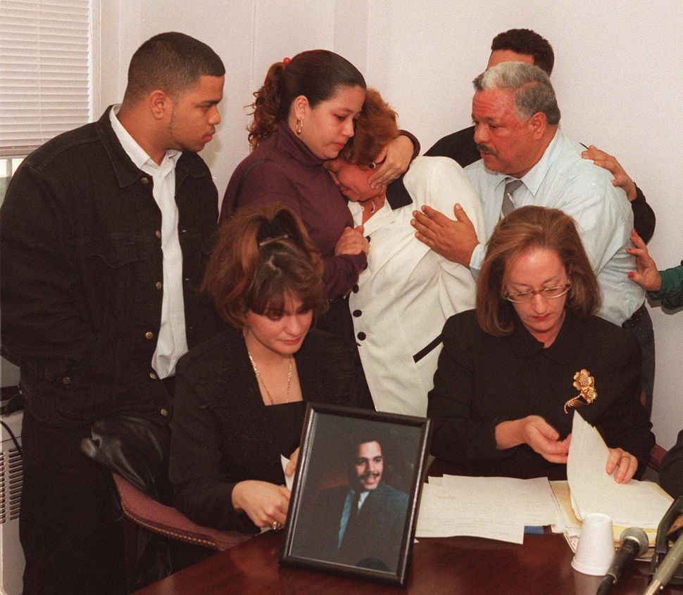 <em>The family of Anthony Baez, who died in police custody on Dec. 22, react Dec. 29, 1994, during a news conference in N