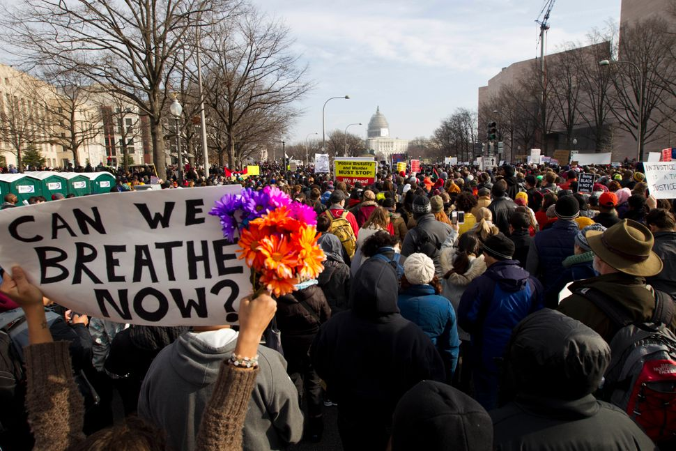 """<em>Demonstrators march toward Capitol Hill in Washington, Saturday, Dec. 13, 2014, during the <br>""""Justice for All"""" march. ("""