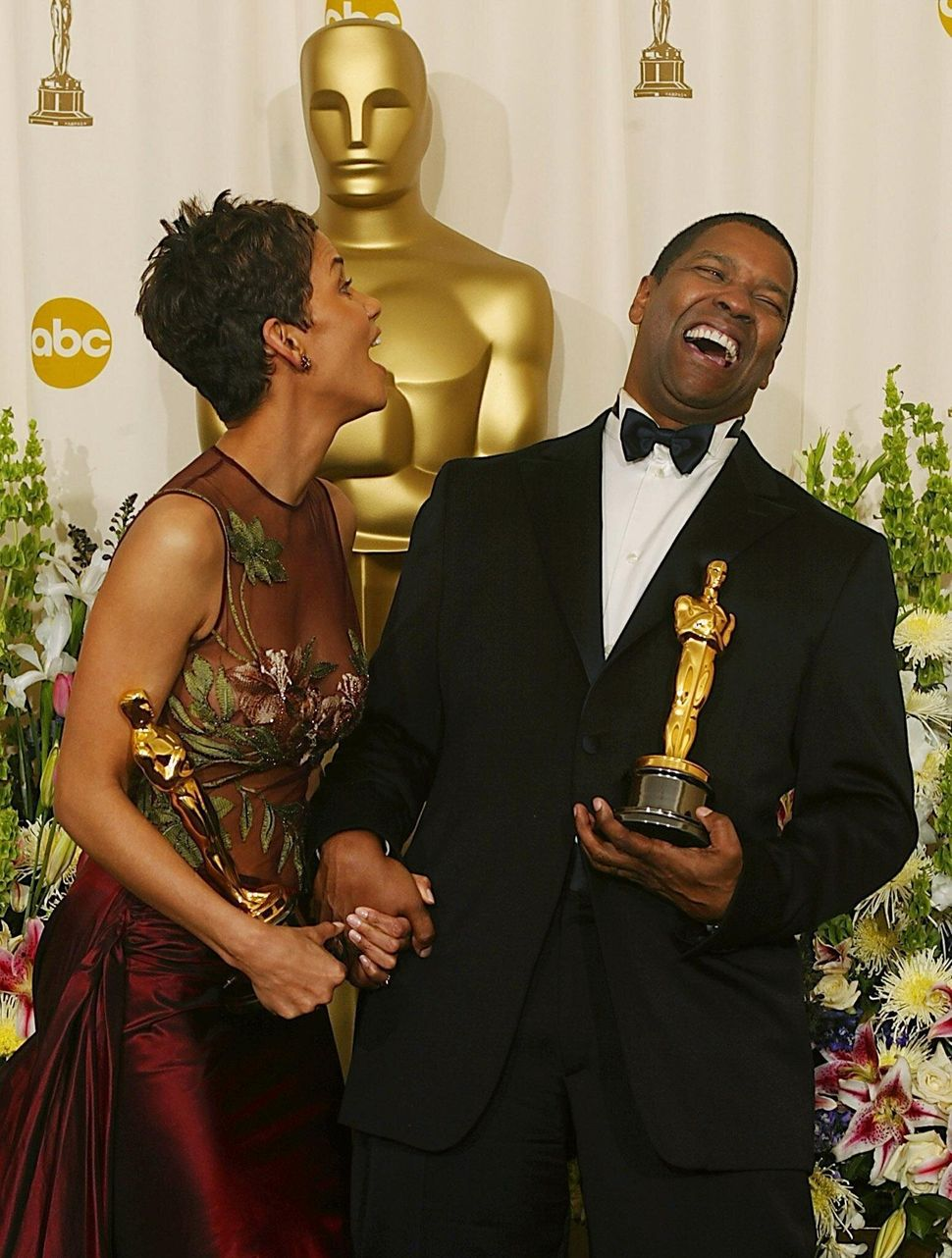 <em> Denzel Washington and Halle Berry share a laugh while holding their Oscar statues after winning the awards for Best Acto