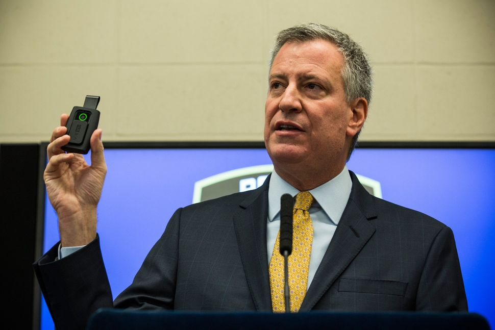 <em>New York City Mayor Bill de Blasio holds up a body camera during a press conference on Dec. 3, 2014, in New York City. (A