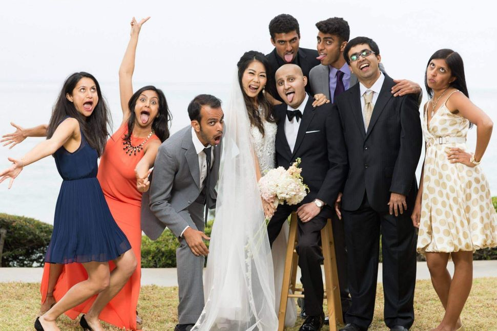 <em>Shah and Chen goof around with family at their wedding in April 2015.</em>