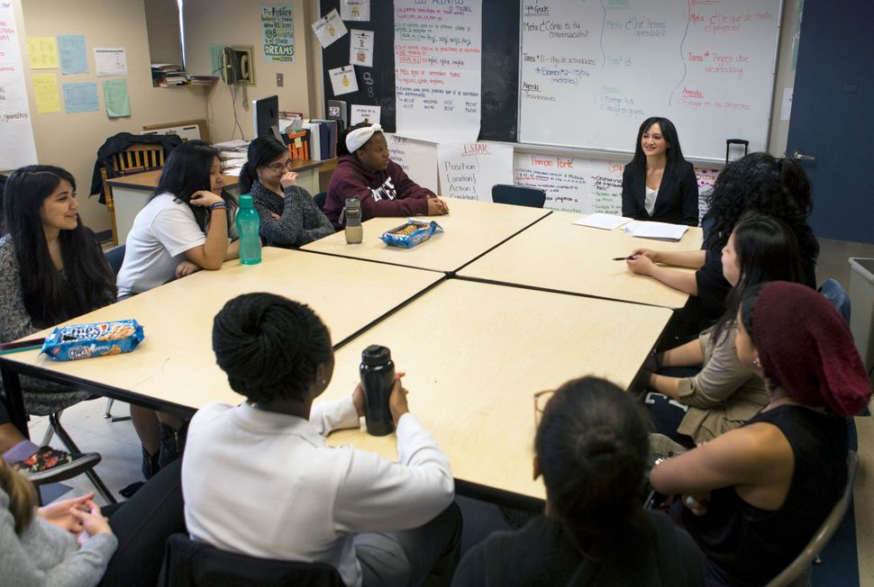 <em>Claudia Espinosa speaks to the L.O.V.E. mentees and mentors at The Young Women's Leadership School of East Harlem.</em>