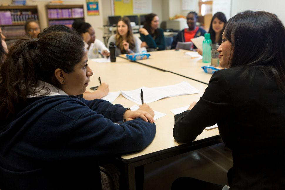 <em>Espinosa (right) speaks with a mentee at The Young Women's Leadership School of East Harlem.</em>
