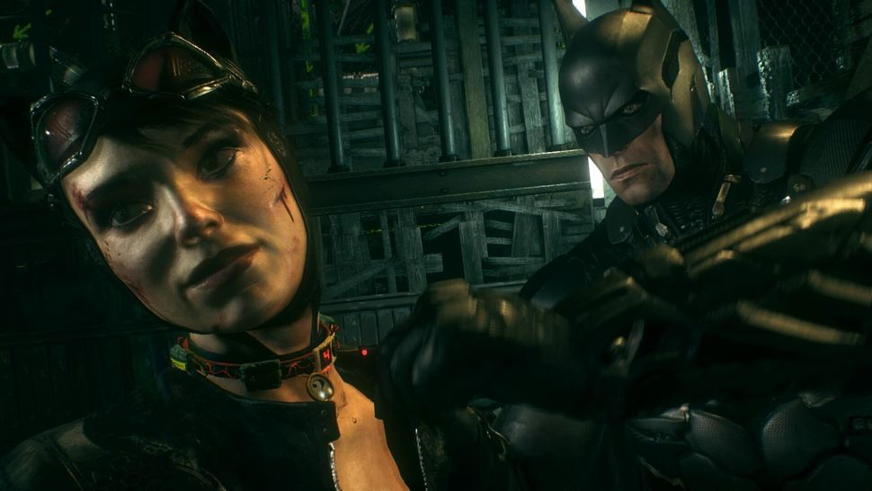 """<em>Batman attempts to deactivate an exploding collar on Catwoman in """"Arkham Knight.""""</em>"""