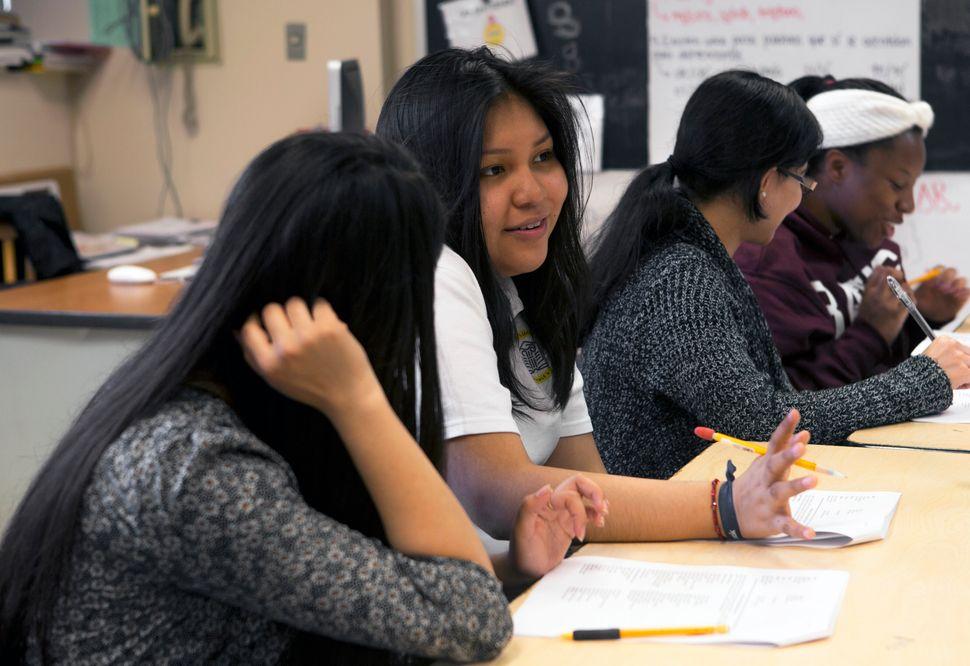 <em>Mentees and mentors talk during an after-school L.O.V.E. meet-up.</em>