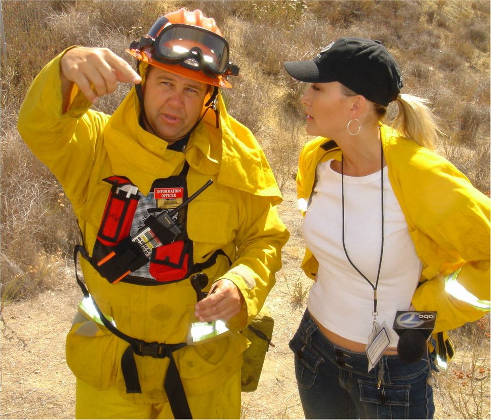 <em>Burch reporting on the California wildfires for KABC in Los Angeles, 2002.</em>