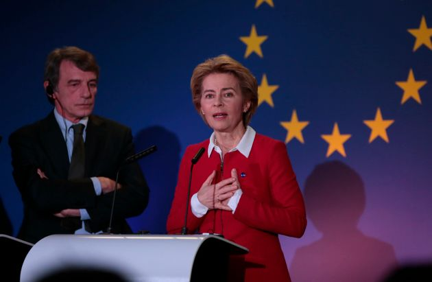 European Commission President Ursula von der Leyen, right, speaks as she participates in a media conference...