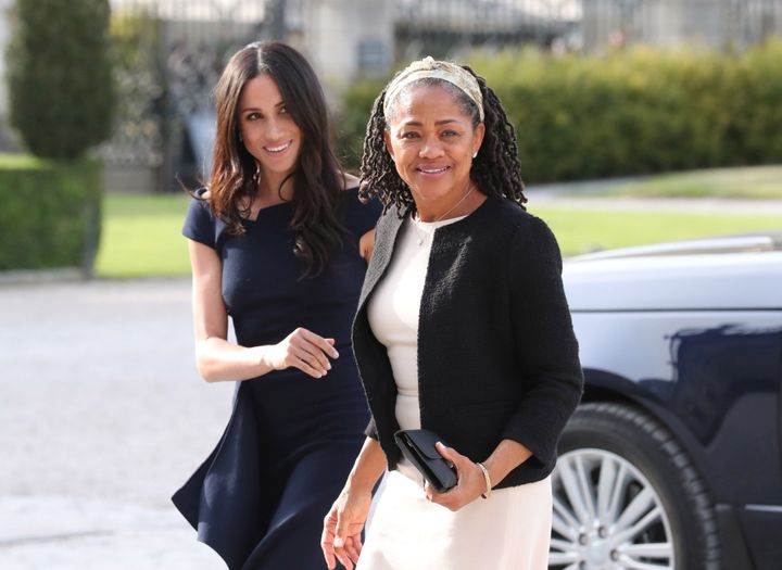 Meghan Markle and her mother, Doria Ragland, arrive at the Cliveden House Hotel in England the day before her wedding to Prin