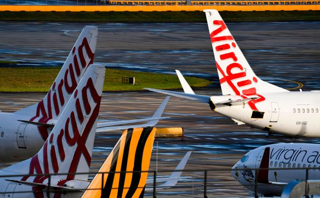 Planes from Australian airlines Tiger Air and Virgin sit idle on the tarmac at Melbourne's Tullamarine...