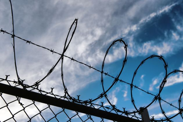 Barbed wire on top of chainlink fence. New York City,