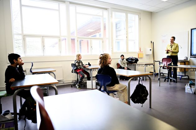 Danish prime minister Mette Frederiksen speaks to pupils as she participates in the reopening of Lykkebo...