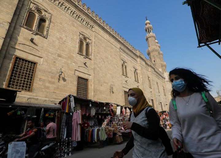 Women wear face masks while walking in Cairo, Egypt, on April 16, 2020, ahead of the Muslim holy month of Ramadan.