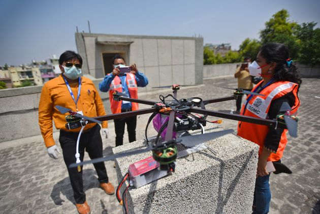 A Municipal Corporation of Delhi (MCD) team prepares a drone during a sanitisation drive in the Hauz...