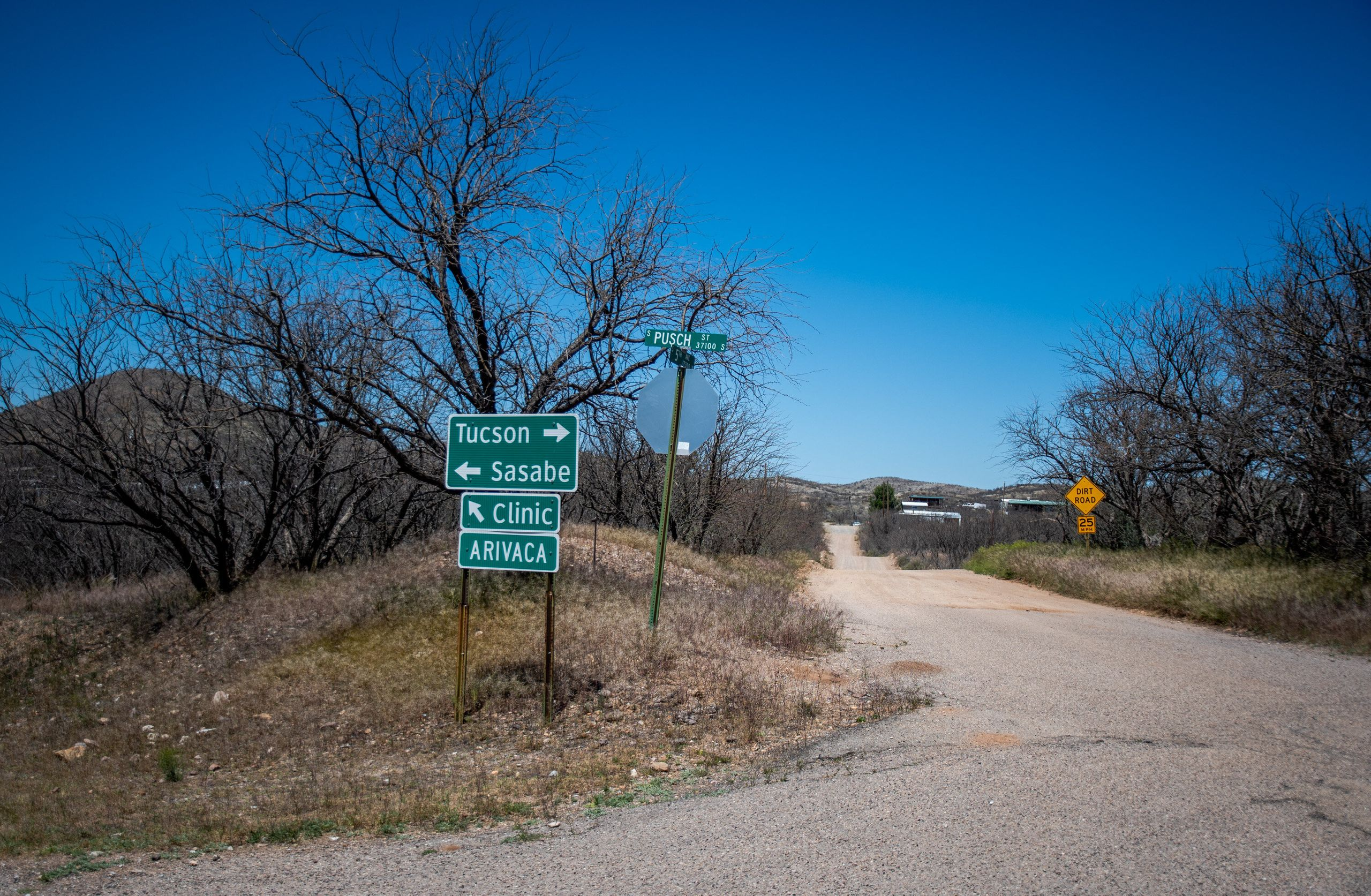 A sign for the only medical clinic in Arivaca marks a junction at the end of town.