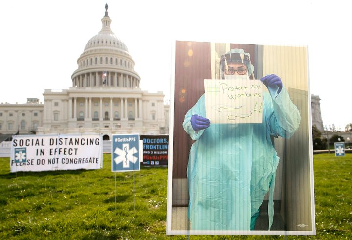In a protest designed to adhere to social distancing guidance, 1,000 signs were arranged on the lawn of the U.S. Capitol Buil