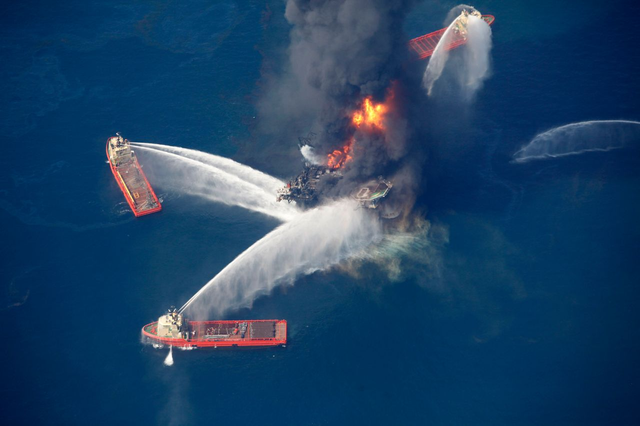 In this aerial photo taken in the Gulf of Mexico, more than 50 miles southeast of Venice on Louisiana's tip, the Deepwater Horizon oil rig is seen burning, April 21, 2010.